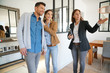 canvas print picture - Couple with real-estate agent visiting house for sale