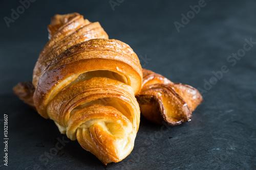 Fotografie, Obraz  Fresh croissants on a dark background
