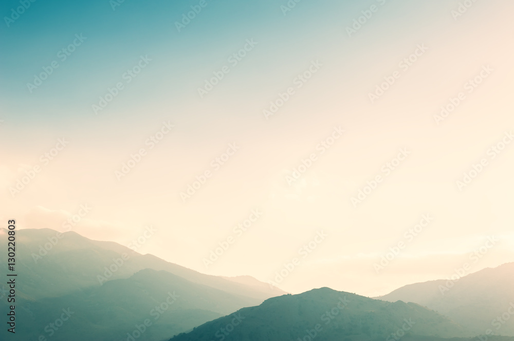 Fototapety, obrazy: Mountains and sky at sunset.