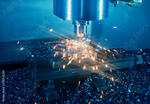 Fotografie, Obraz  Milling machine working on steel detail with lot of sparks