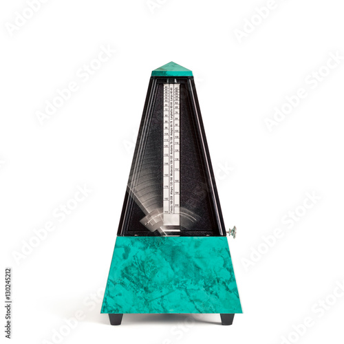 Fotografia, Obraz  Moving pyramid shaped metronome in plastic housing in sapphire green with marble