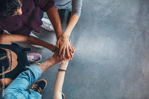 Fotografía  Group Of young people stacking their hands