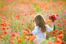Child Picking Wild Flowers In ...