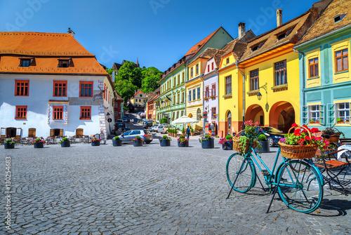 Fotografie, Obraz  Famous medieval street cafe bar,Sighisoara,Transylvania,Romania,Europe