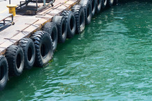 Row Of Black Car Tires Used As Boat Bumpers