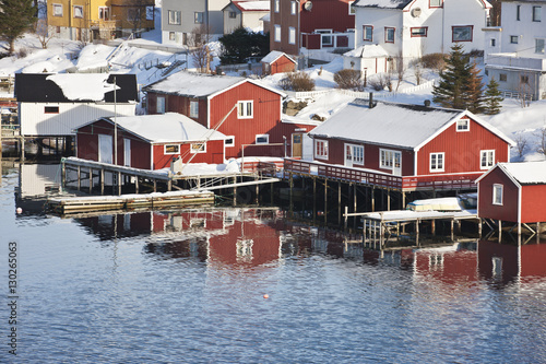 City on the water Wooden cabins at the waters edge in the town of Raine in the Lofoten Islands, Arctic, Norway, Scandinavia, Europe