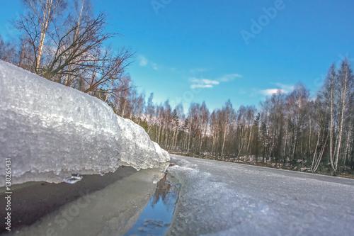 Foto op Aluminium Blauw frozen river near forest