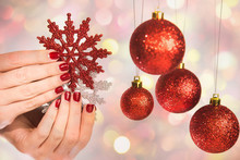 Close Up Of Caucasian Female Hands With Professional Holiday Red And Silver Manicure With Glittering Sparkles Isolated On Christmas Background. Modern Festive Gel Polish With Base Coat First And Top