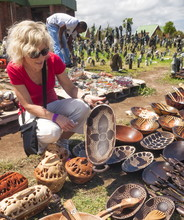 Blond Woman Buying African Painted Wooden Bowl Souvenirs, Outdoor Market, Plettenberg Bay, Garden Route