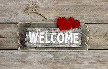 Rustic Welcome Sign With Two Red Fabric Hearts