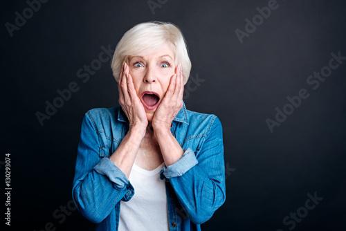 Fotografija Pleasant elderly woman expressing wonder