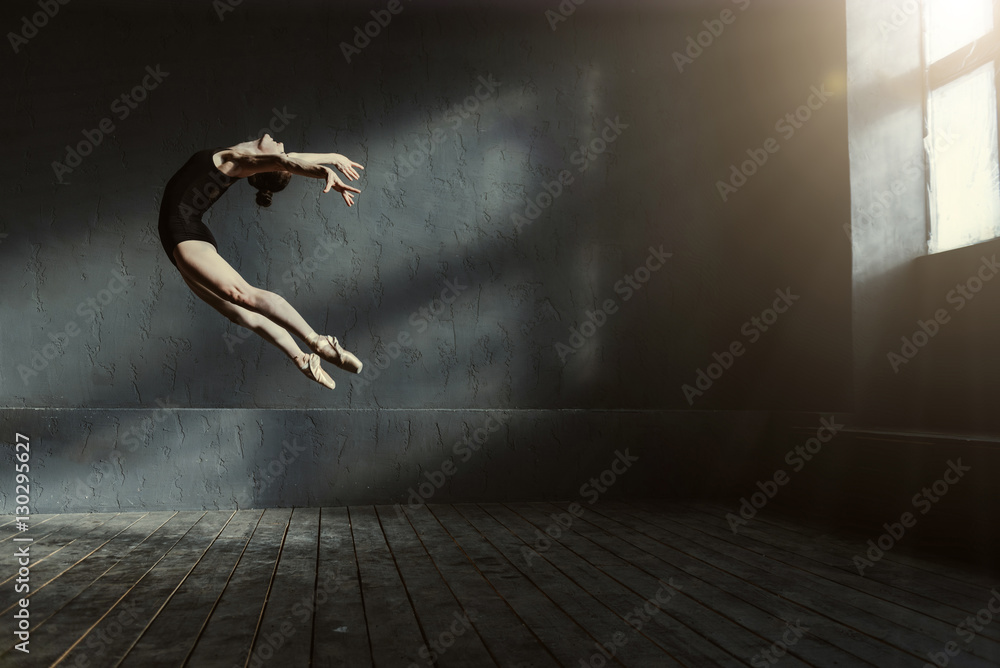 Fotografie, Obraz  Professional ballet dancer performing in the dark lighted room