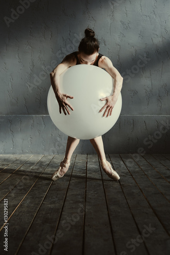 Fotografie, Obraz  Static ballet dancer performing using the white balloon