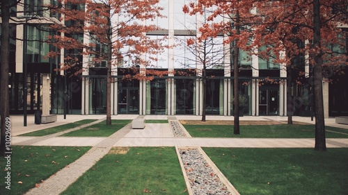 Fototapeta Modern expensive business center. Office buildings with big windows and autumn courtyard obraz