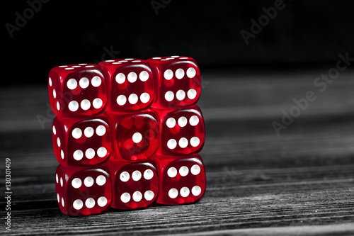 concept luck - dice gambling on dark wooden background плакат