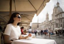 Young Woman Enjoying Espresso At Restaurant, Piazza Navona, Rome