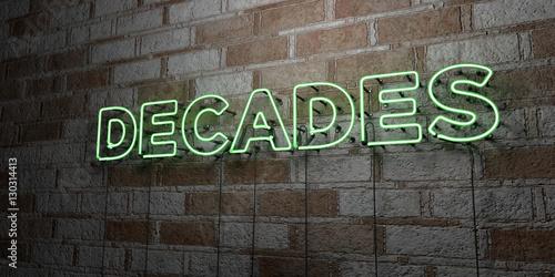 Valokuvatapetti DECADES - Glowing Neon Sign on stonework wall - 3D rendered royalty free stock illustration