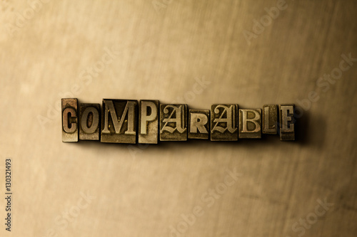 Fotografia, Obraz  COMPARABLE - close-up of grungy vintage typeset word on metal backdrop