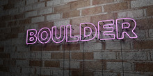 BOULDER - Glowing Neon Sign On Stonework Wall - 3D Rendered Royalty Free Stock Illustration.  Can Be Used For Online Banner Ads And Direct Mailers..