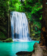 Erawan waterfall, the beautiful waterfall in forest at Erawan National Park - A beautiful waterfall on the River Kwai. Kanchanaburi, Thailand