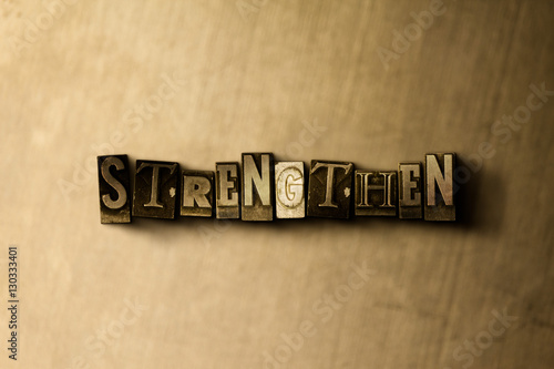 Photo  STRENGTHEN - close-up of grungy vintage typeset word on metal backdrop