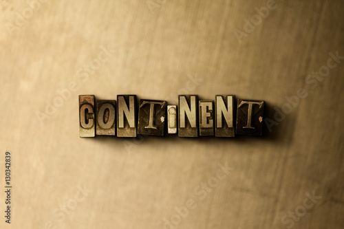 CONTINENT - close-up of grungy vintage typeset word on metal backdrop Poster