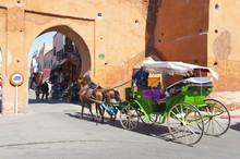 Tourists In Marrakech Enjoying A Horse And Cart Ride Around The Old Medina, Marrakech, Morocco