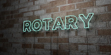 ROTARY - Glowing Neon Sign On Stonework Wall - 3D Rendered Royalty Free Stock Illustration.  Can Be Used For Online Banner Ads And Direct Mailers..
