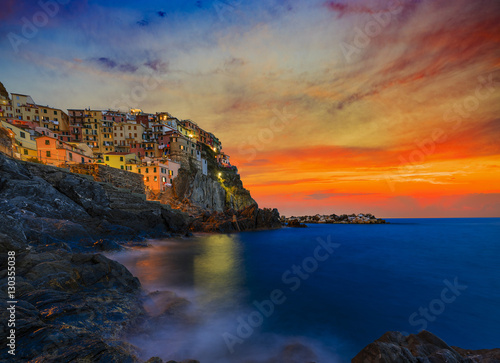 Cinque Terre colorful traditional houses on a rock over Mediterranean sea after sunset at the dusk, Manarola, , Italy, Ligurian Coast Poster