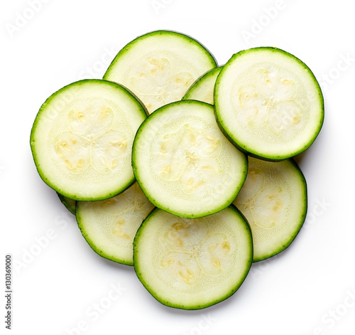 Zucchini slices isolated on white, from above