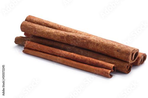Foto Pile of cinnamon sticks, paths