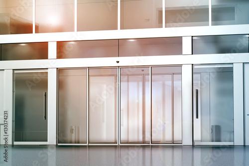 office entrance doors. blank sliding glass doors entrance mockup, 3d rendering. commercial building entry mock up. office