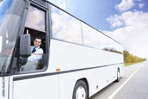 Handsome driver sitting in bus