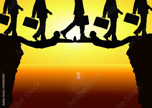Fotografie, Obraz  チームワークのイメージビジネスマンの集団で橋を架けて進む