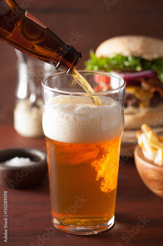 pouring india pale ale beer into pint glass and fastfood Canvas Print
