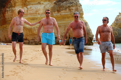 Group Of Male Friends On The Beach