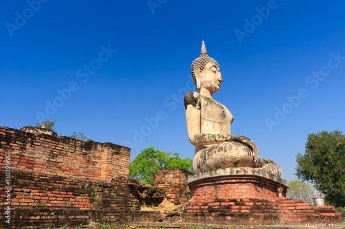 Obraz na plátně  Ancient Buddha Statue at Sukhothai historical park, Thailand.