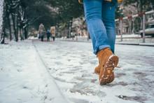Woman Walking In Winter Road