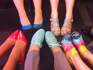 Female legs in fashion shoes. Colorful fashion shoes on feet.