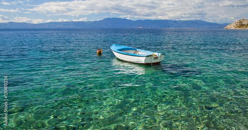Tuinposter Schipbreuk Paradise Turquoise Adriatic Sea with white boat. Krk Island, Croatia, Europe
