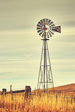 Retro Toned Windmill Tower, American Wild West Symbol.