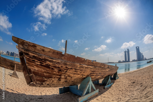 Photo  City Abu Dhabi with wooden boats in United Arab Emirates