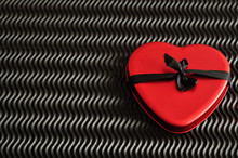 Valentine's Day. A Red Heart Tied With A Black Ribbon