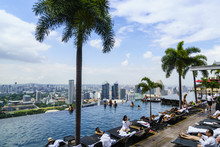 Infinity Pool On The Roof Of The Marina Bay Sands Hotel With Spectacular Views Over The Singapore Skyline, Singapore