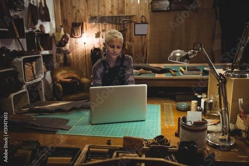 Craftswoman using laptop