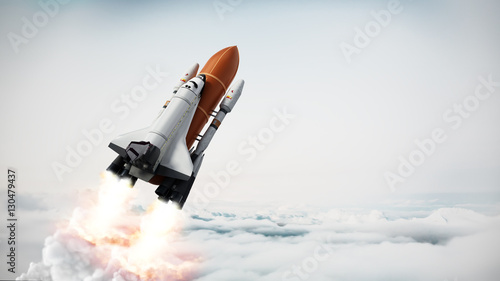 Valokuva  Rocket carrying space shuttle launches off. 3D illustration