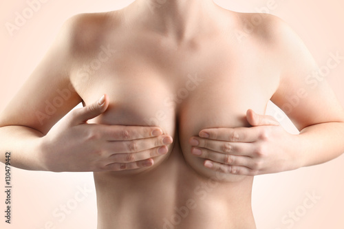Fototapeta Woman breast, closeup. Plastic correction and surgery concept.