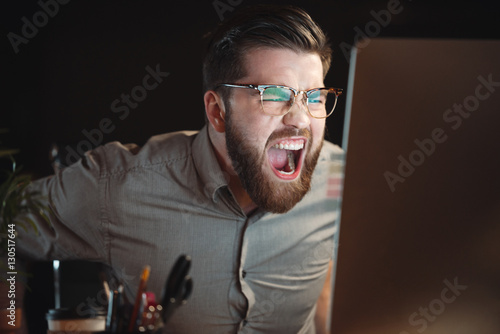 Bearded designer working with computer late at night and screaming Wallpaper Mural