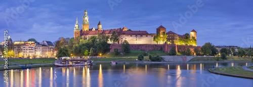 Fototapeta panorama of night lights above old castle obraz