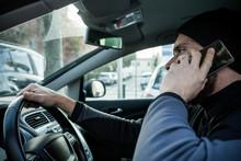 Man Phoning And Driving